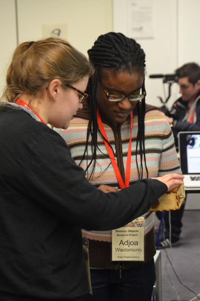 Adjoa showing Sarah her Sensory Label