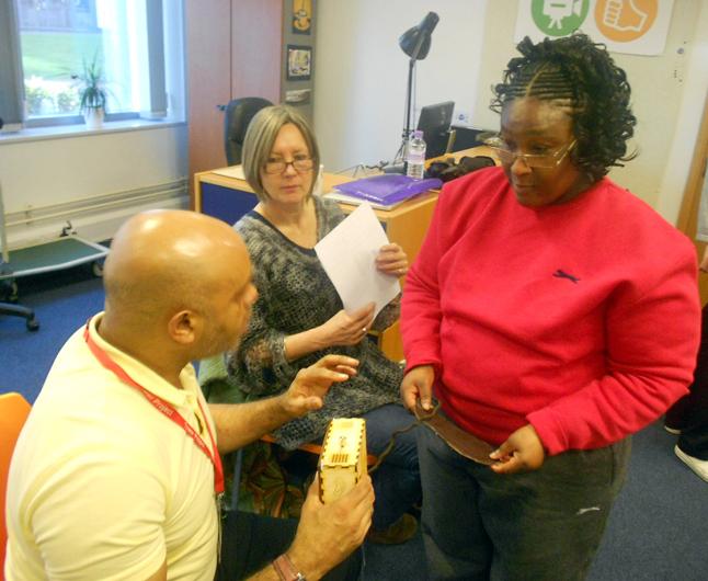 Judith shows John a sensory label
